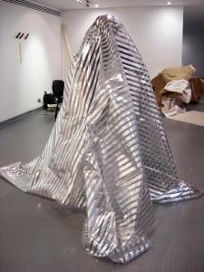 """Surveillance Blanket"" by Daniel Baker (2008); gilded polythene;  4m x  3m; (c)  Danel Baker"